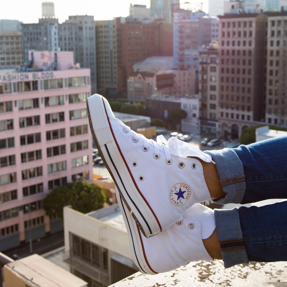 Lizette takes in the view of LA in her Optical White Chucks from her rooftop.