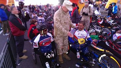 Freddie Uzeta and General James F. Amos, commandant of the U.S. Marine Corps, at the starting line with Joe Beimfohr