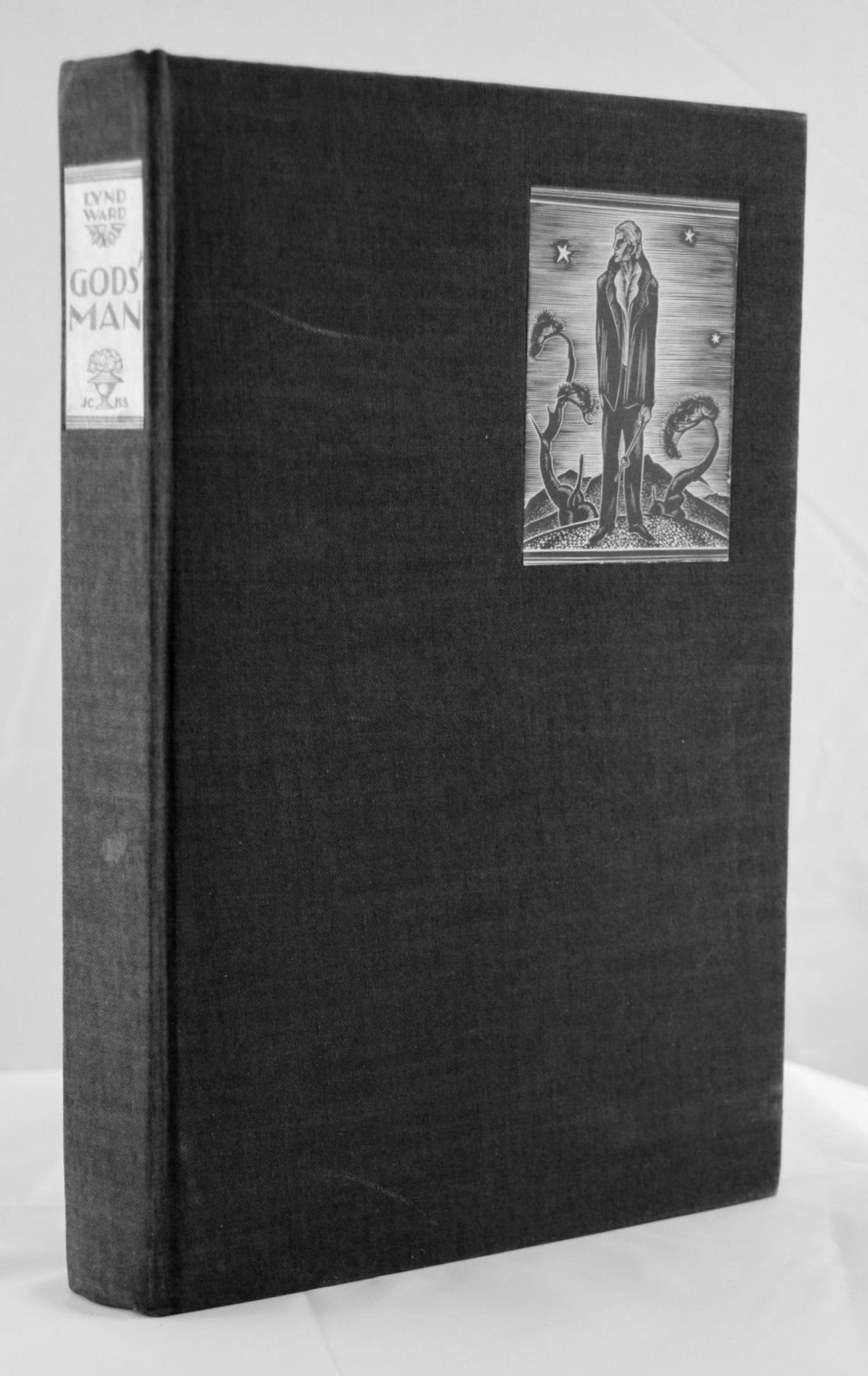 "Lynd Ward: Gods' Man   New York: The Aldus Printers and J. F. Tapley Company for Jonathan Cape & Harrison Smith,  1929. Hardcover, octavo, 6-1/2"" x 9-3/4"". ""Special edition, 409 copies (of which 376 are for sale)"", printed directly from Lynd Ward's original wood engravings. This is number 49. Black cloth with black end papers in exceptionally good condition, with paper labels on spine and front board. One small spot on the spine visible in the accompanying photograph and two light scratches on the front cover. T.e.g.; a few pages have been carelessly opened, resulting in minor tearing to their edges. The binding is tight and square; the pages are crisp and clean; bookplate of Douglas Fairbanks, Jr. on the front paste-down. Signed by Ward on the copyright page. Lacks slip case.       $1,600"