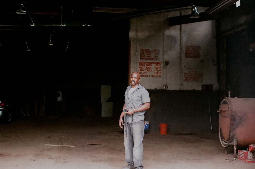 Jerry Esters, the owner of the garage, overseeing the renovation.