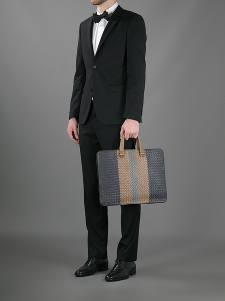 mens black suit and briefcase
