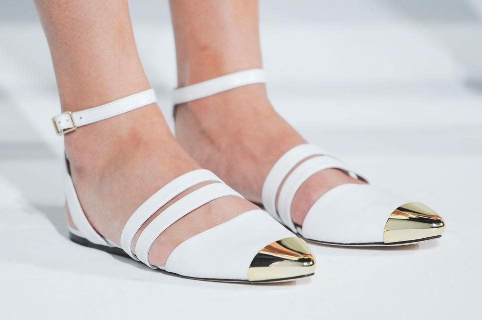 white strapped metal cap shoes