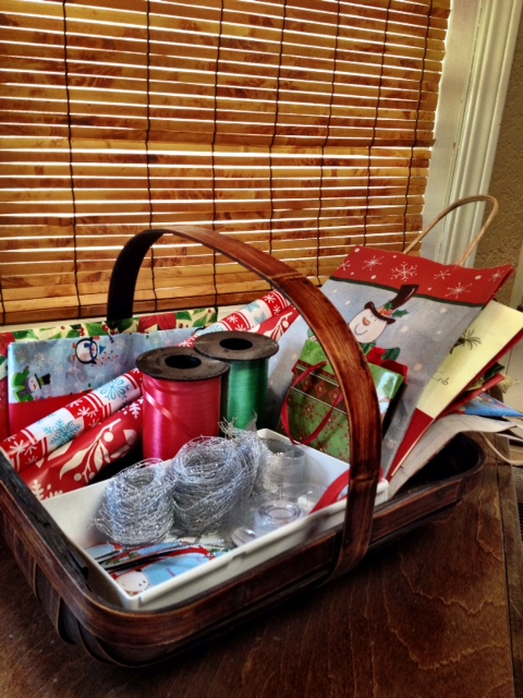 Our gift wrapping station is a simple basket that sits on the laundry room counter