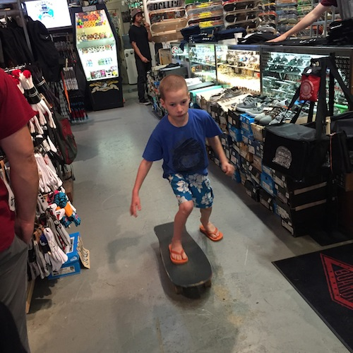 And he skateboards through the Santa Cruz store.