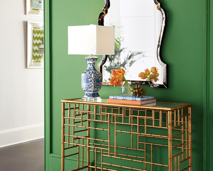via  Horchow   Another way to add color is to paint the wall instead of the furniture. I love the gold leafed bamboo style table and having a mirror when you walk out the door is always a good idea.