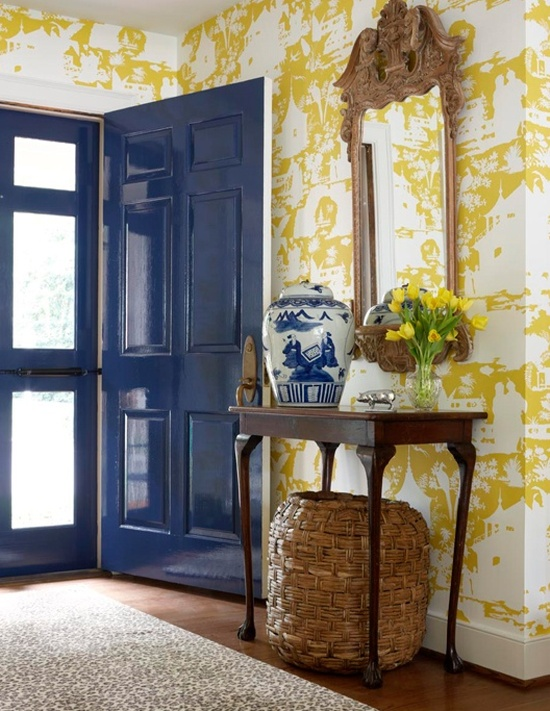 via  Suellen Gregory   Nice contrast between the woven basket and unpainted mirror against the very formal chinoiserie paper. The high-gloss blue door is a nice surprise.
