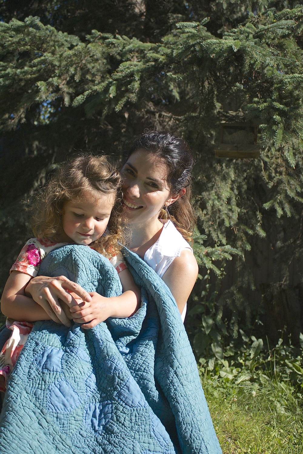 Photography provided by Red House West - Mera and her daughter Opal with a thrifted quilt that she over-dyed with indigo.
