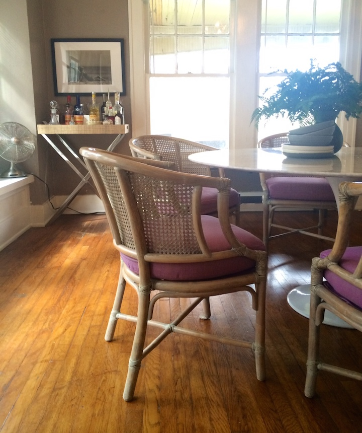 Ellen found these gorgeous 1960's rattan chairs on 1st Dibs.  Their pairing with her Saarinen-inspired round marble table has us swooning.