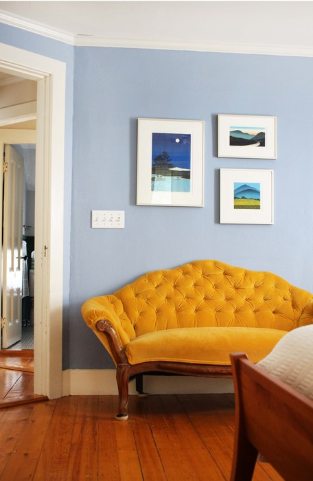 This collection of three  Sabra Field  woodcut relief prints hangs above our Little Yellow Couch in my bedroom.