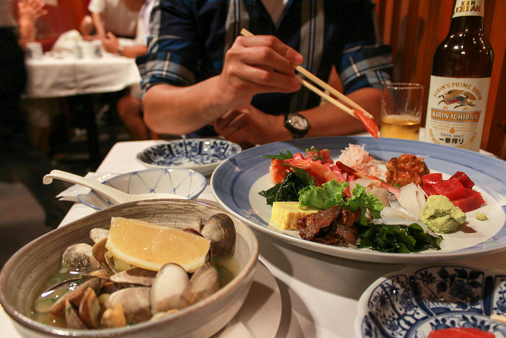Steamed Clams and Sashimi Deluxe. He makes my heart flutter when he waits for me to set up the pic before he eats.