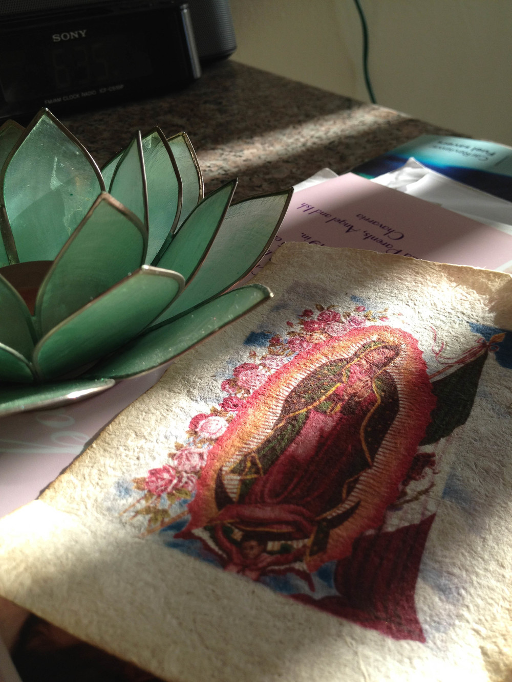 I have an obsession with Virgin Mary prints, lotus flowers,and natural light.