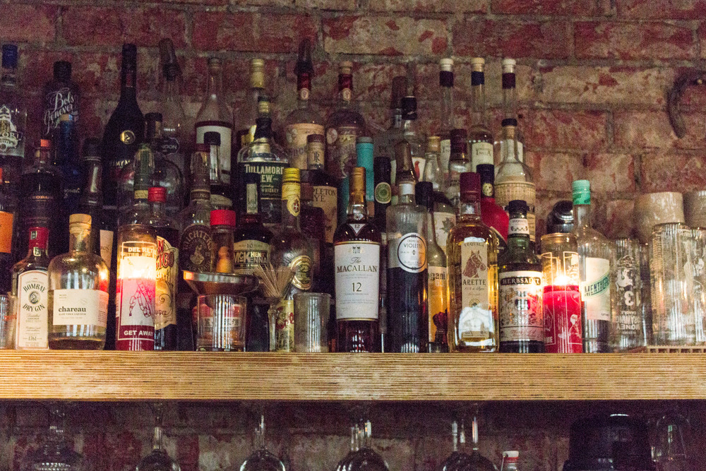 The bar shelves alight with candles set the mood for the magic of the evening.