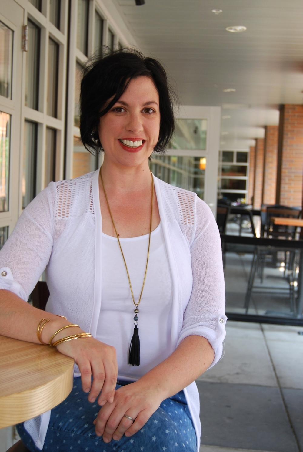 Jen wearing Kisa mesh cardigan in white, racer back tank, star denim capris with Litany leather tassel necklace