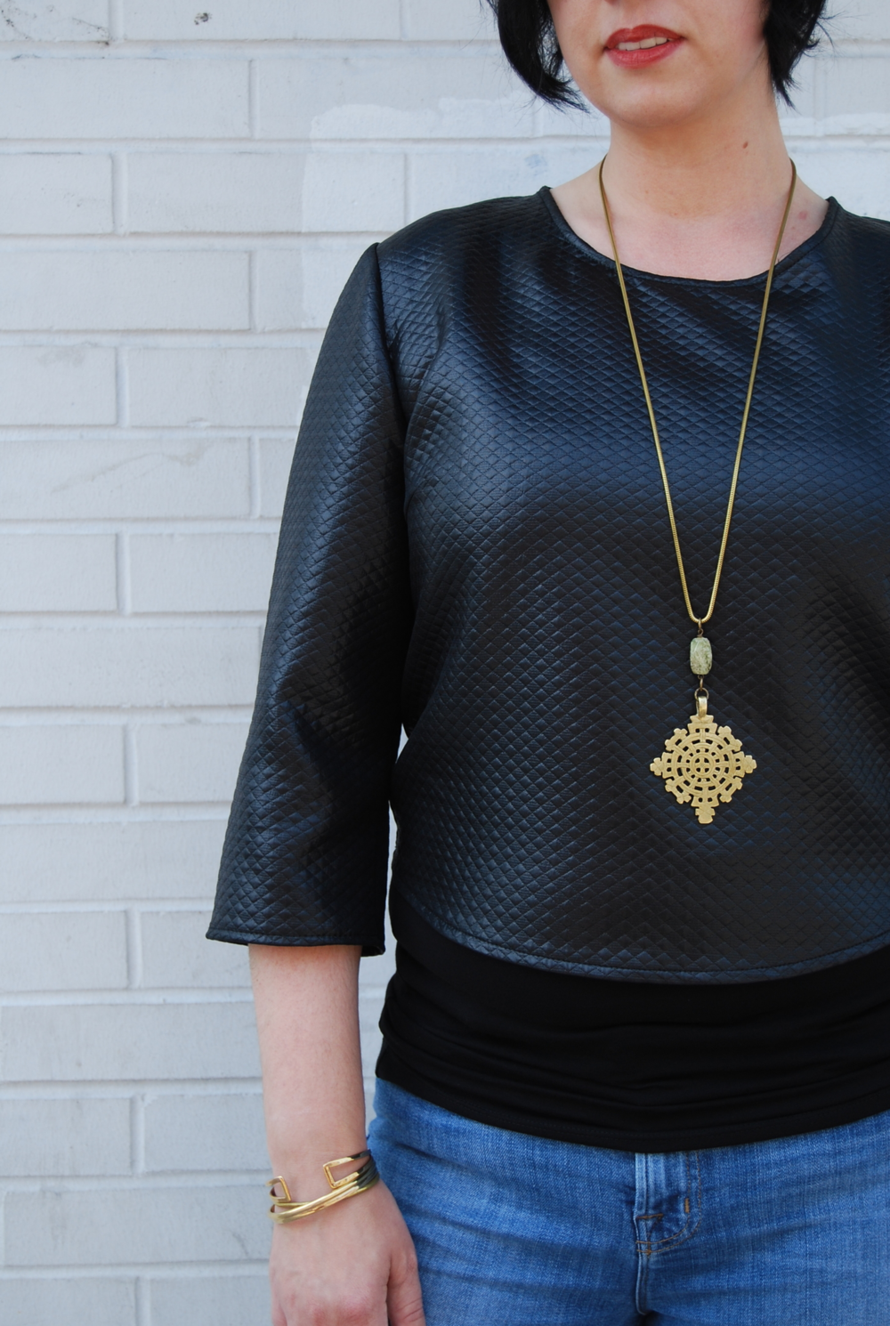 Jen wearing the Kisa quilted crop top with Litany Coptic cross necklace