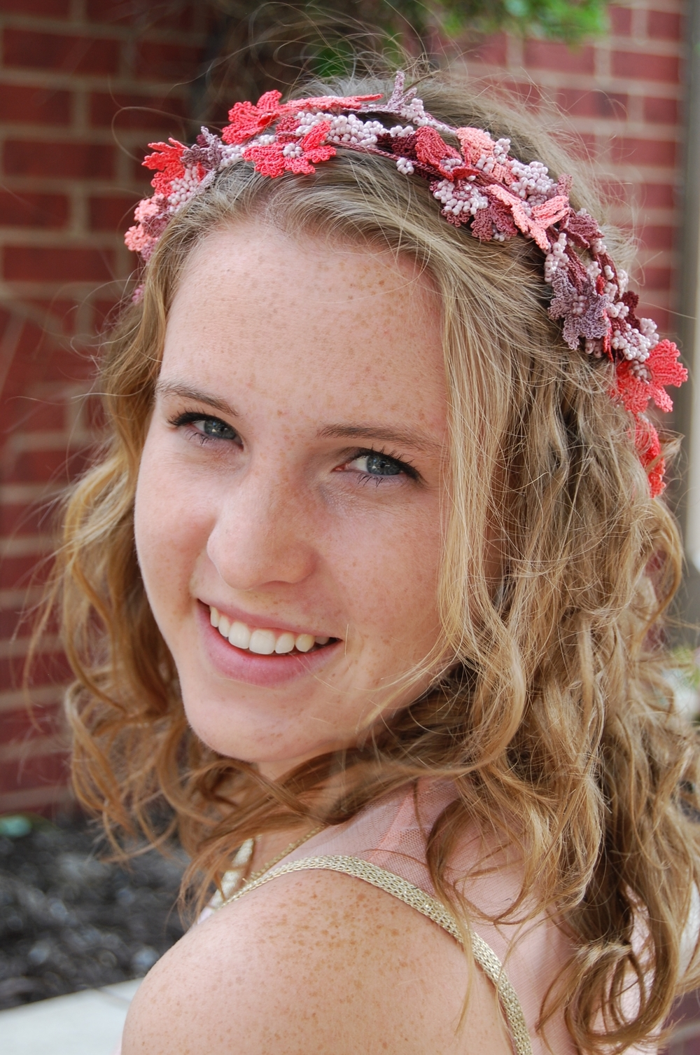 Maria doning our Kisa Signature OYA lace flower crown or necklace—handmade & one of a kind.