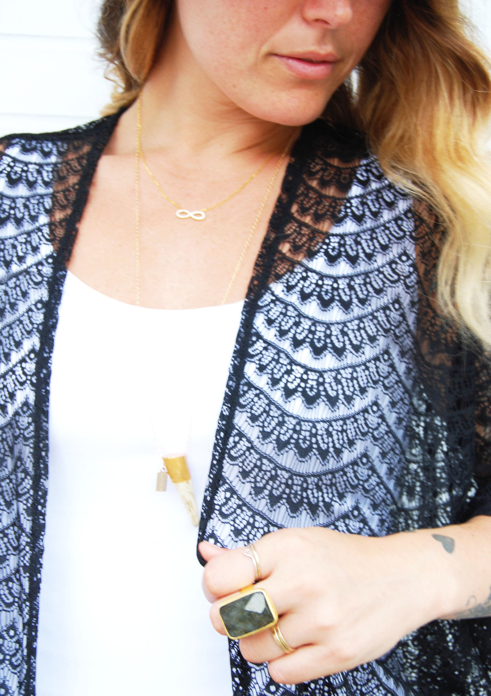 KISA Infinity necklace in gold $48 // Tess + Tricia gold capped antler $28 // Turkish statement ring $24