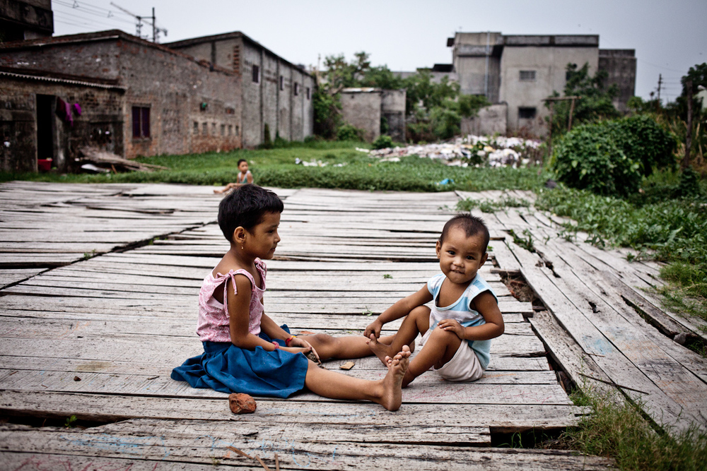 Children play in the ruins of one of China Towns old tanneries