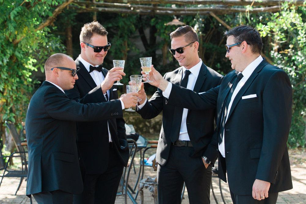 ravello-wedding-groomsmen-hugo-boss-suits-toast