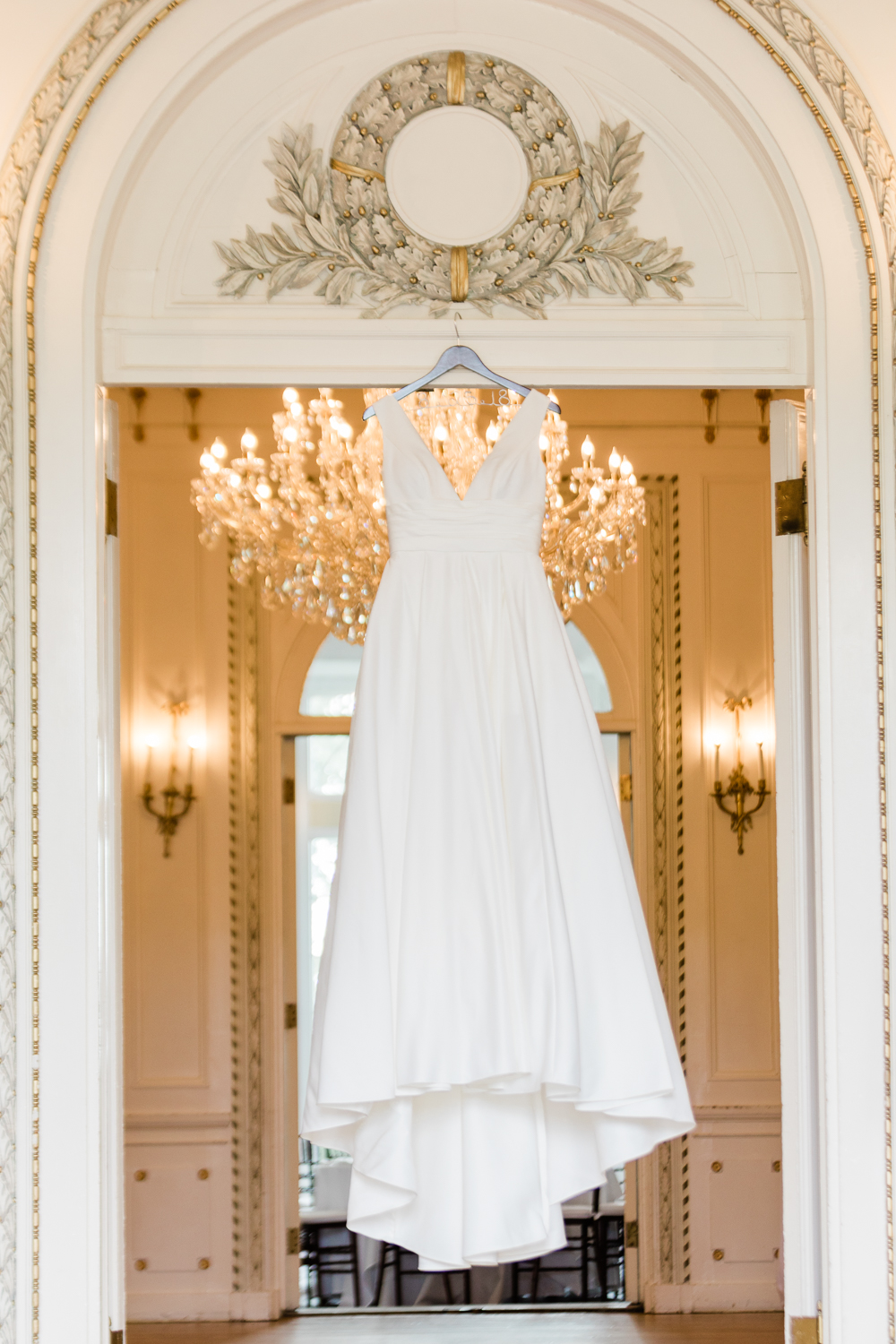 Beautiful wedding dress hanging in doorway