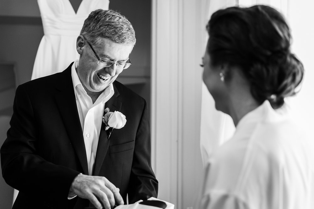 Father of the bride receiving a gift