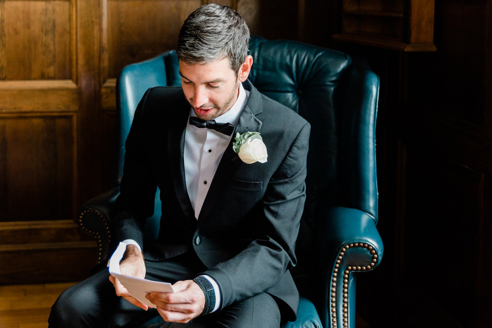 Groom reading a letting written by the bride