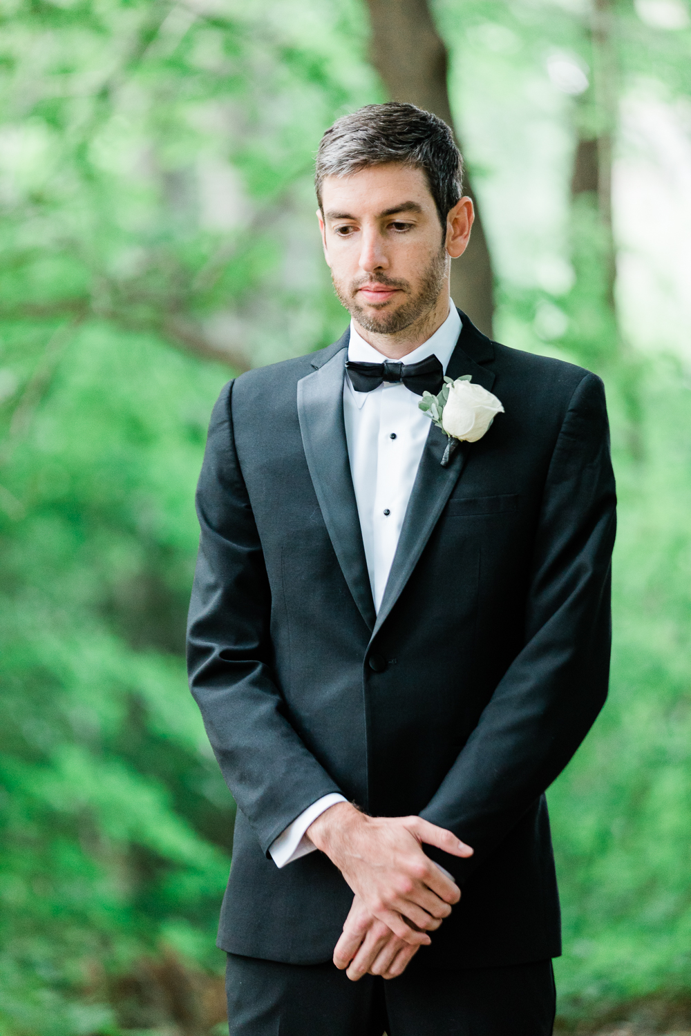 Groom waiting for bride before first look
