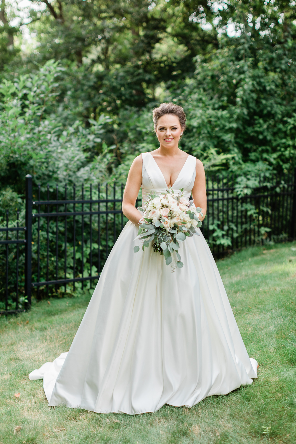 Beautiful Bride Holding a bouquet by Evan's Flowers