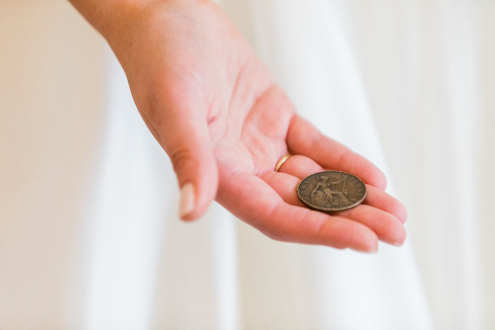 Bride Holding an antique irish penny