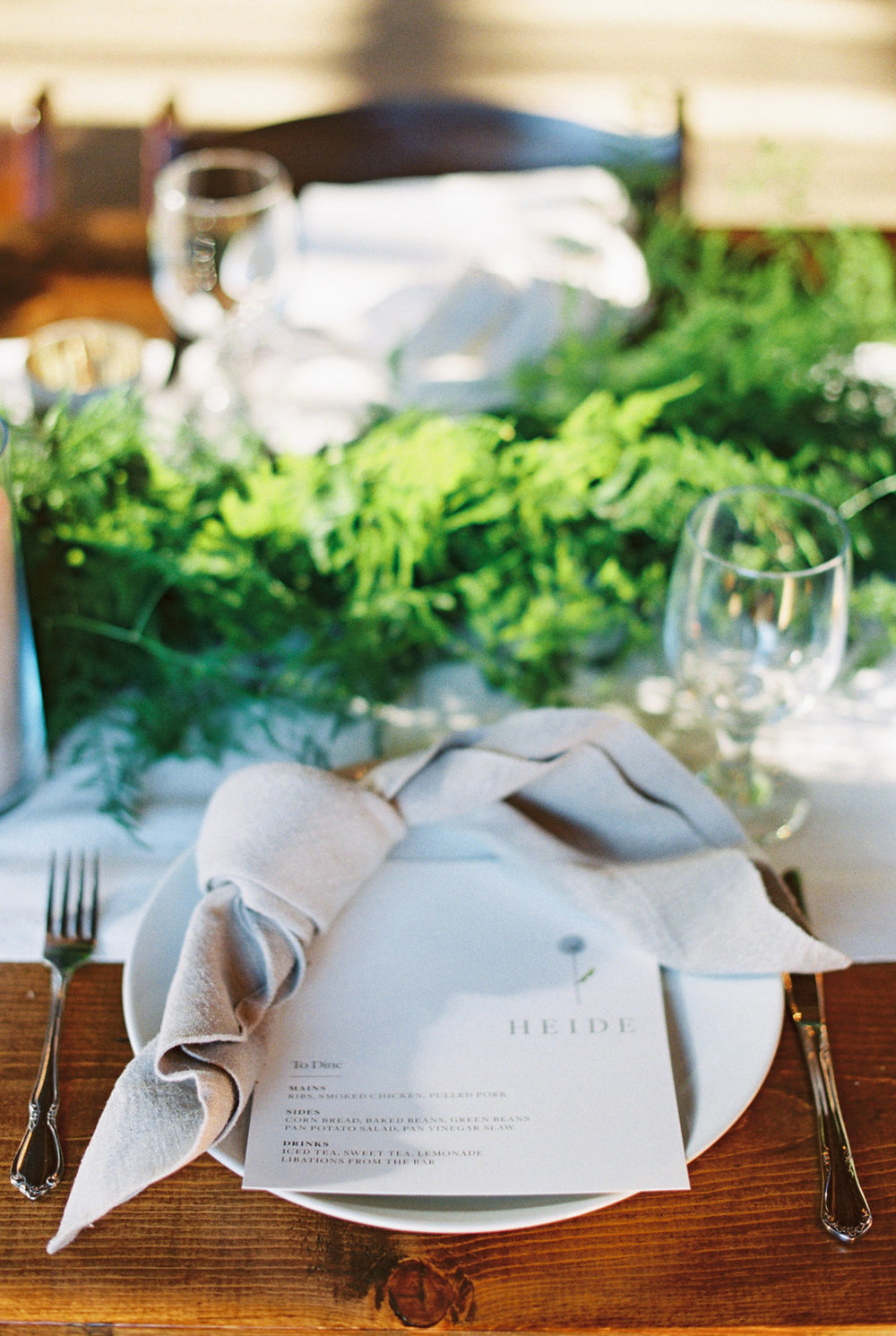 Custom menu place cards for a spring farm wedding, combining classic style with the natural environment.