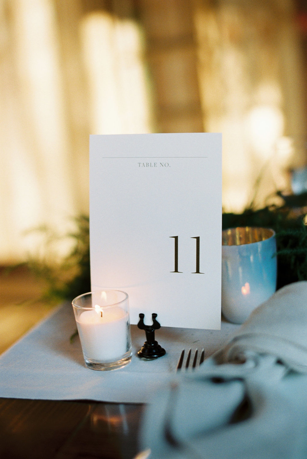 Custom table numbers for a spring farm wedding, combining classic style with the natural environment.