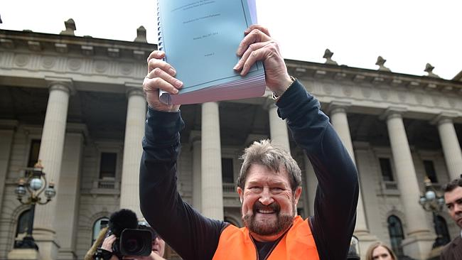 Derryn Hinch waves the petition in front of Parliament House. Picture source: Tony Gough