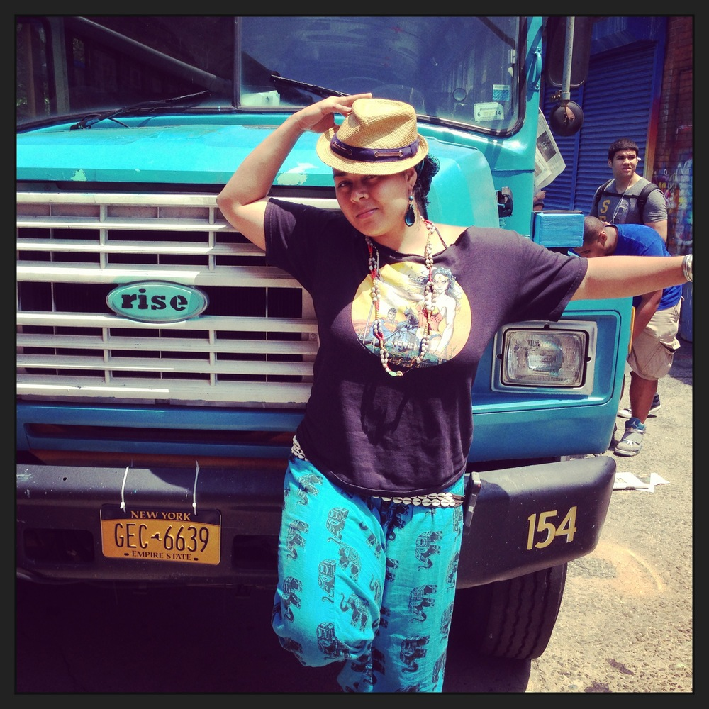 Artist Crystal Clarity takes a break from painting the bus to give us an ill pose.