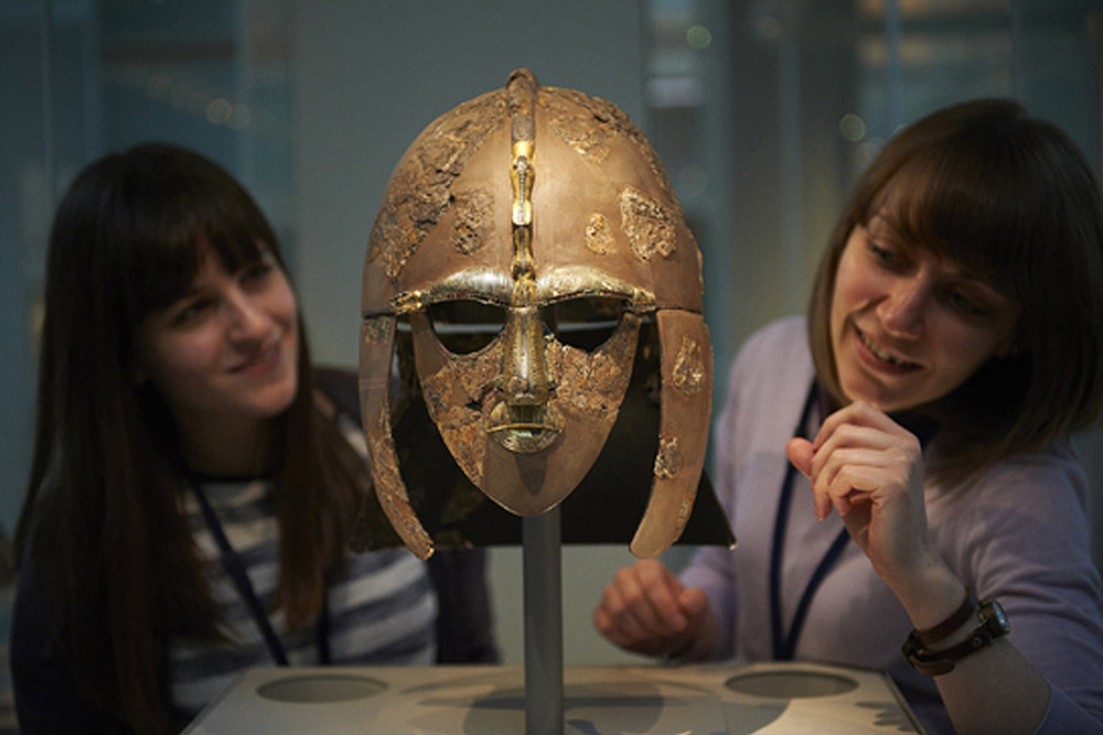 Curators Rosie Weetch and Sue Brunning check the Sutton Hoo helmet