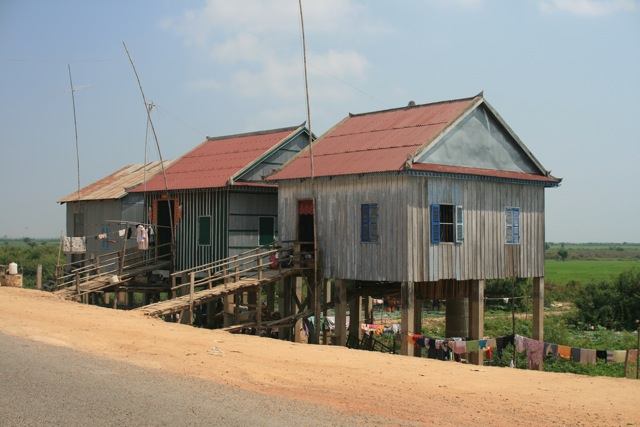 Houses on the road (Cambodia, between Siem Reap and Phnom Penh)
