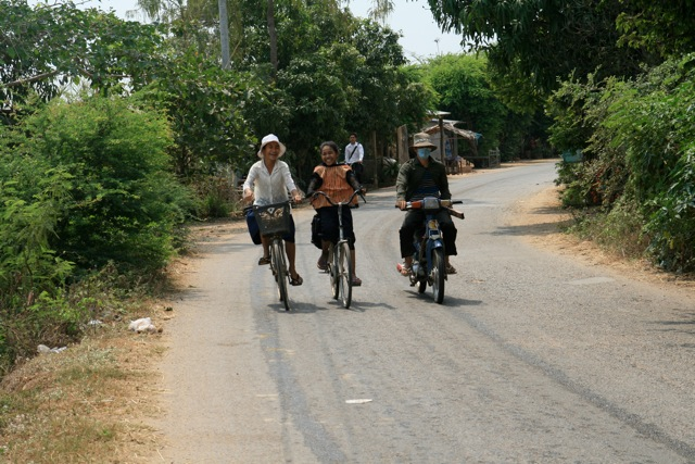 Cheerful bikers (Cambodia, between Phnom Penh and Kratie)