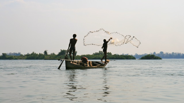 Boys fishing on the Mekong river