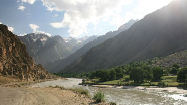 In Tajikistan, looking across the river to the pretty villages in Afghanistan