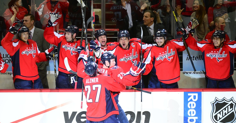 Teammates celebrate with forward Jason Chimera shortly after giving the Capitals a 3-1 midway through the second period. Photo courtesy of The Washington Post