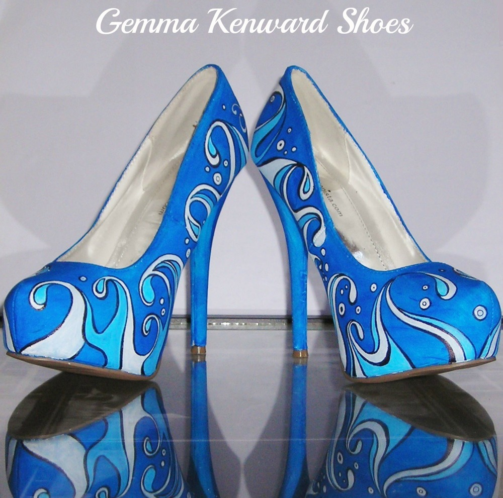 Custom wedding shoes hand painted with blue stylized waves and white writing.