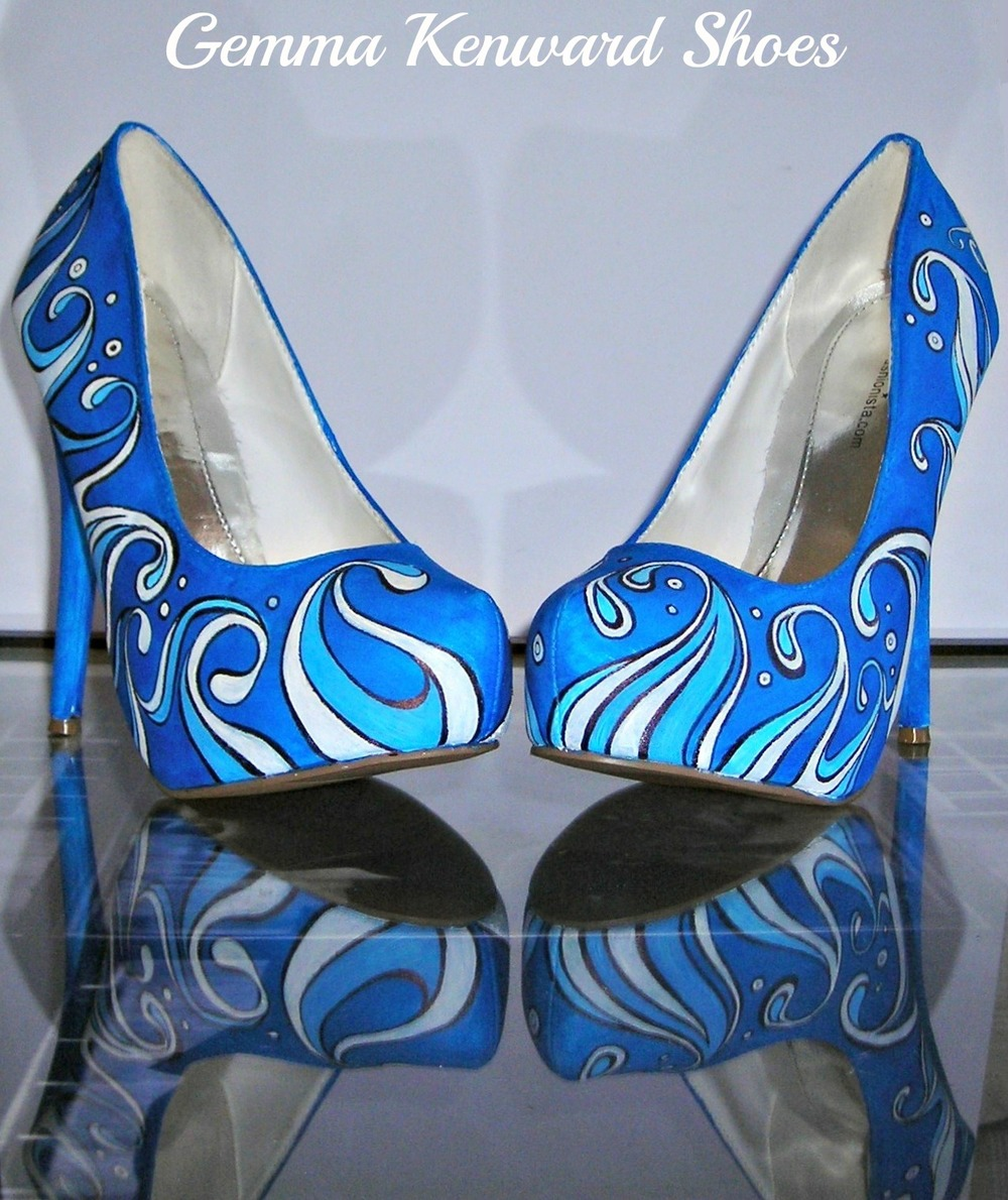 Personalised wedding shoes hand painted with waves to fit a beach theme.