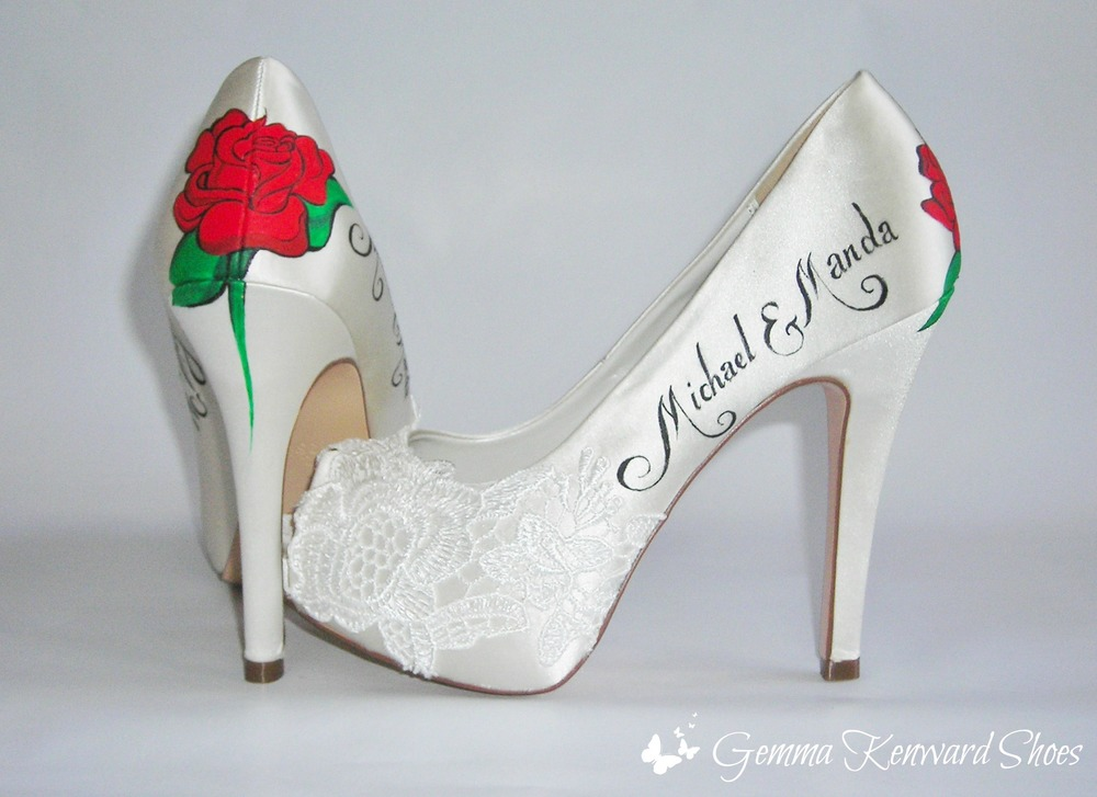 Red roses hand painted on a pair of high heeled wedding shoes.  A gift from the groom to his future wife.