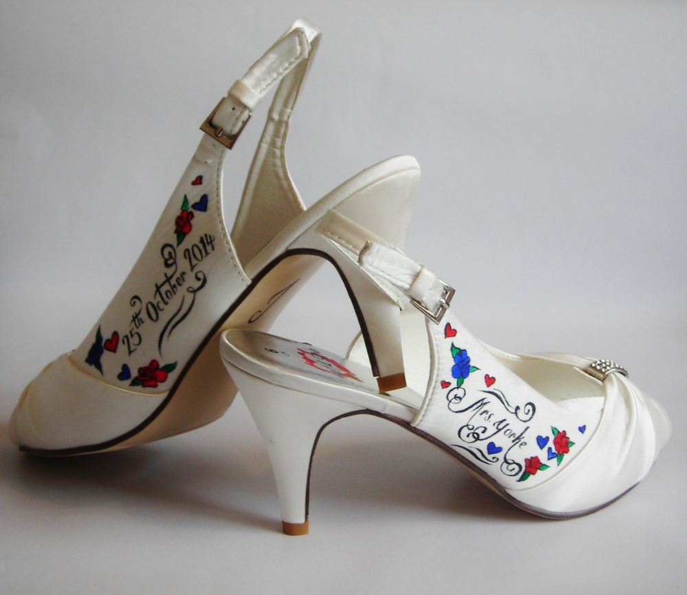 Red and blue roses on a pair of sling back wedding shoes given as a wedding gift.