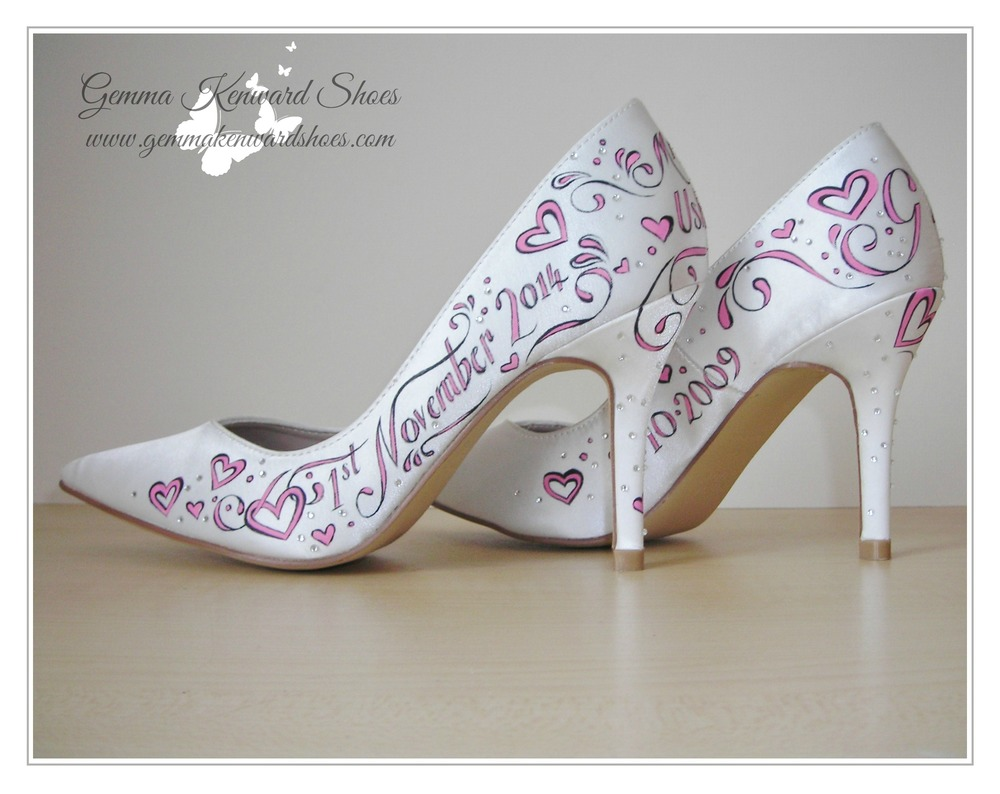 Hand painted pink wedding shoes with butterflies and jewels.jpg