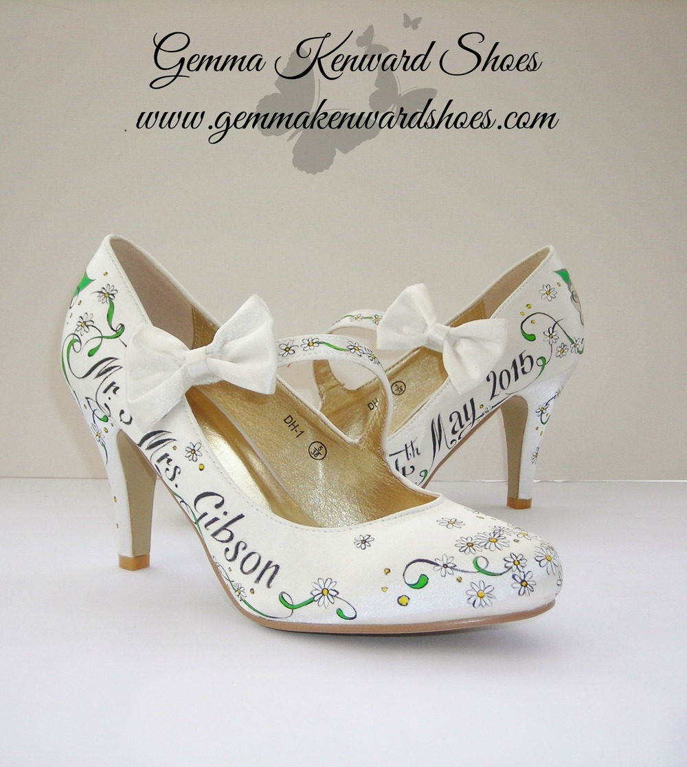 Hand painted ivory wedding shoes with daisies and roses .