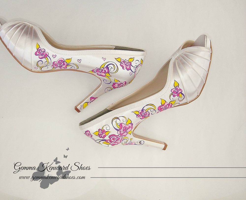 Personalised hand painted wedding shoes with purple and pink roses with yellow and gold detailing.