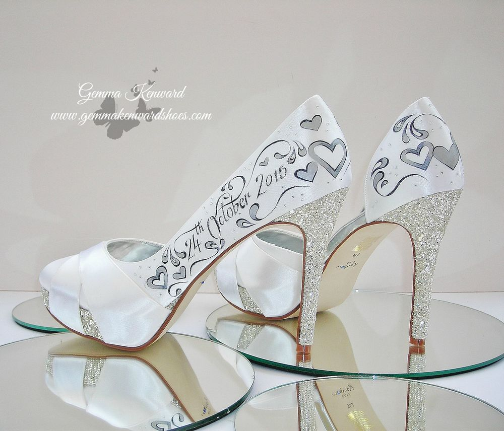 Silver hearts painted on a pair of Rainbow Club wedding shoes