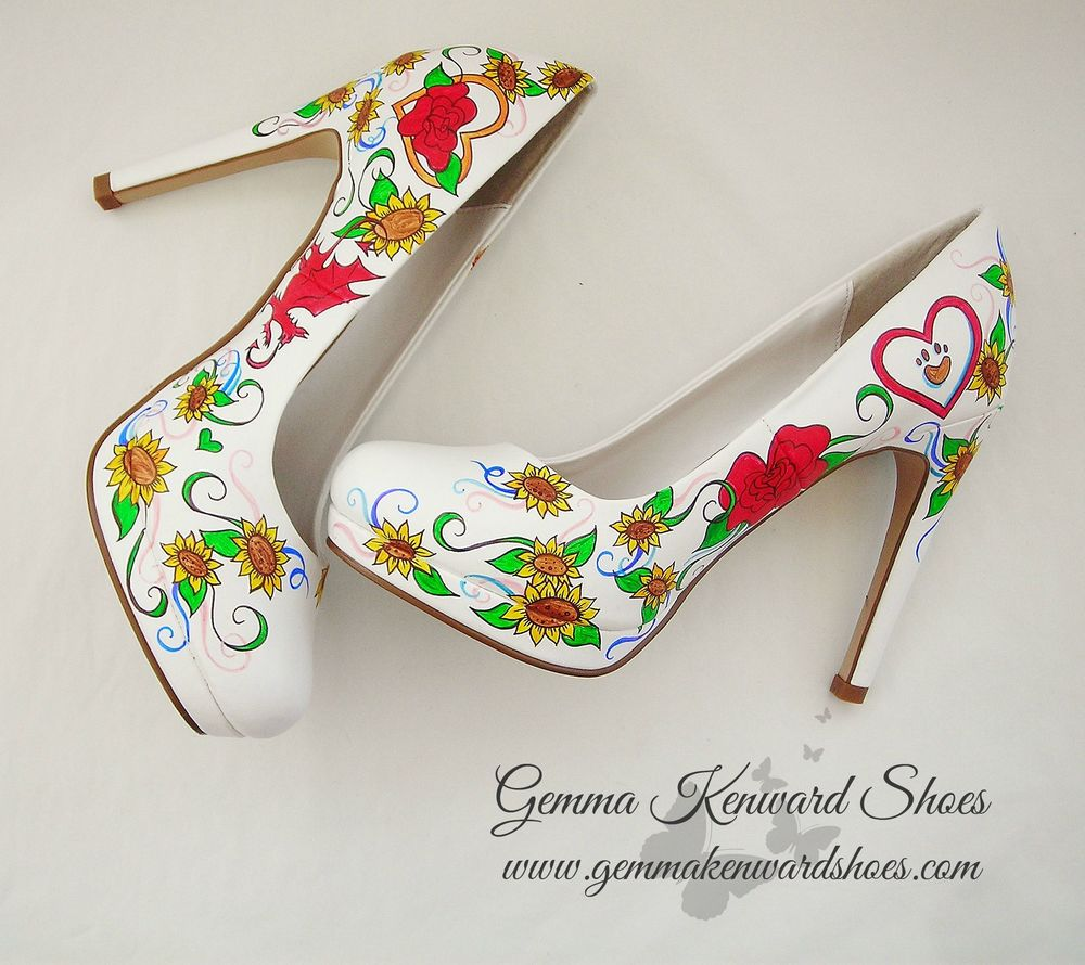 Sunflowers, red roses and a dog portrait amongst other things all illustrated on a pair of wedding shoes