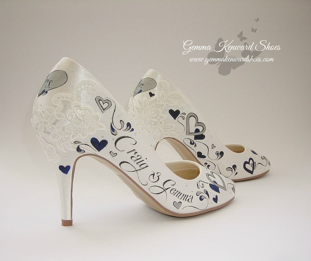 Lace on a pair of hand painted brides shoesace bridal shoes with L