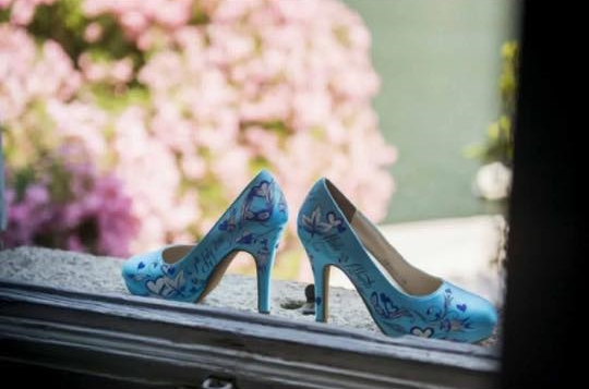 Hand painted blue wedding shoes with feathers, flowers, hearts and leaves for a wedding in Greece