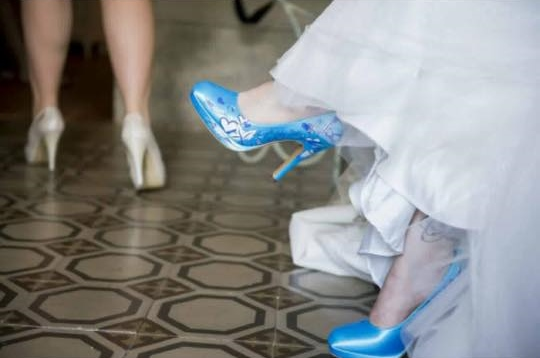 Blue wedding court shoes painted with dates of the wedding and the bride and grooms names.